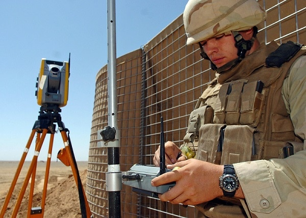 090904-N-4440L-003 HELMAND PROVINCE, Afghanistan (Sept. 4, 2009) Engineering Aide 3rd Class William Anderson, assigned to Naval Mobile Construction Battalion (NMCB) 74, programs a Trimble S6 Total Station robotic surveying system. This advanced technology provides Anderson with precise stakeout points for the perimeter of the Camp Leatherneck expansion project. (U.S. Navy photo by Mass Communication Specialist 2nd Class Michael Lindsey/Released)